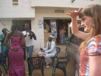 Drummers welcome Ami to the house and alert the guests on the roof to her arrival