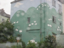 Mural of green field and sheep