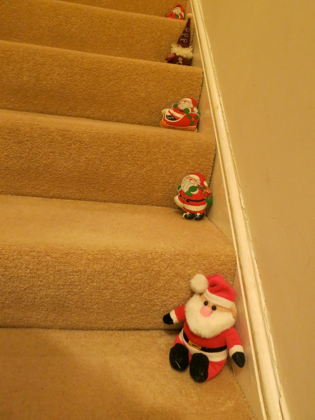 Father Christmases all the way up the stairs