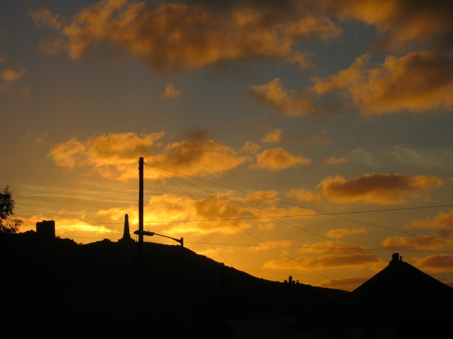 Tonight's sky, Carn Brea Castle, Carn Brea Monument, chimneys and telegraph wires