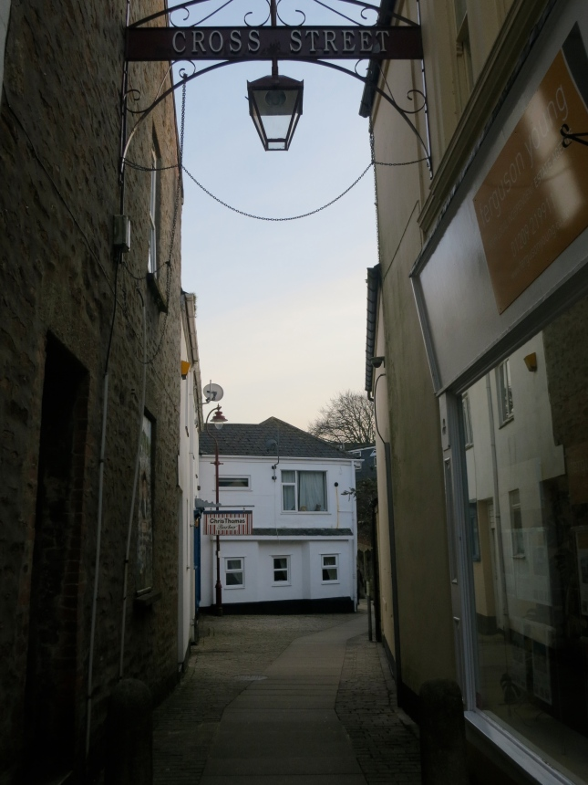 Cross Street, the alley where the barbers are