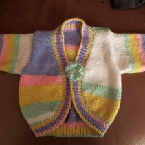 Curved front cardigan made for new baby due this year
