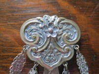 Decorative clasp with belt hook behind