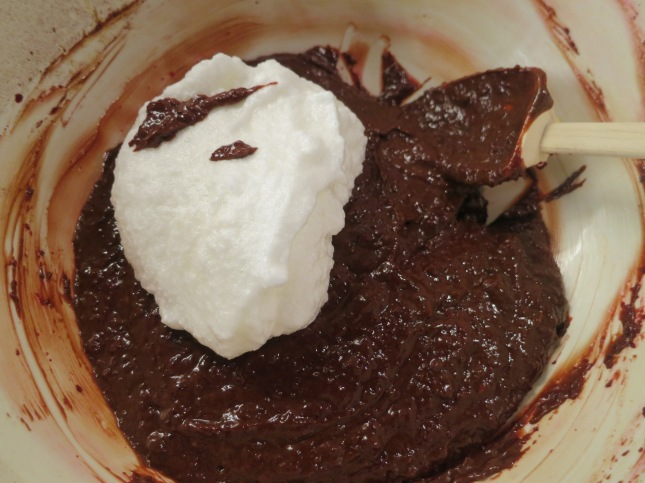 Mixing a bit of whisked egg white into the chocolate