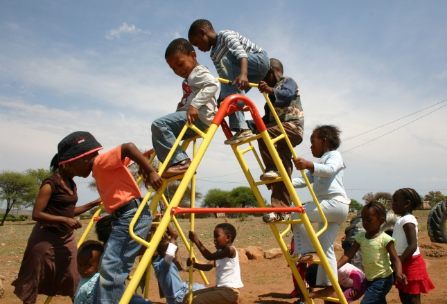 Children on the climbing frame in Mapoch