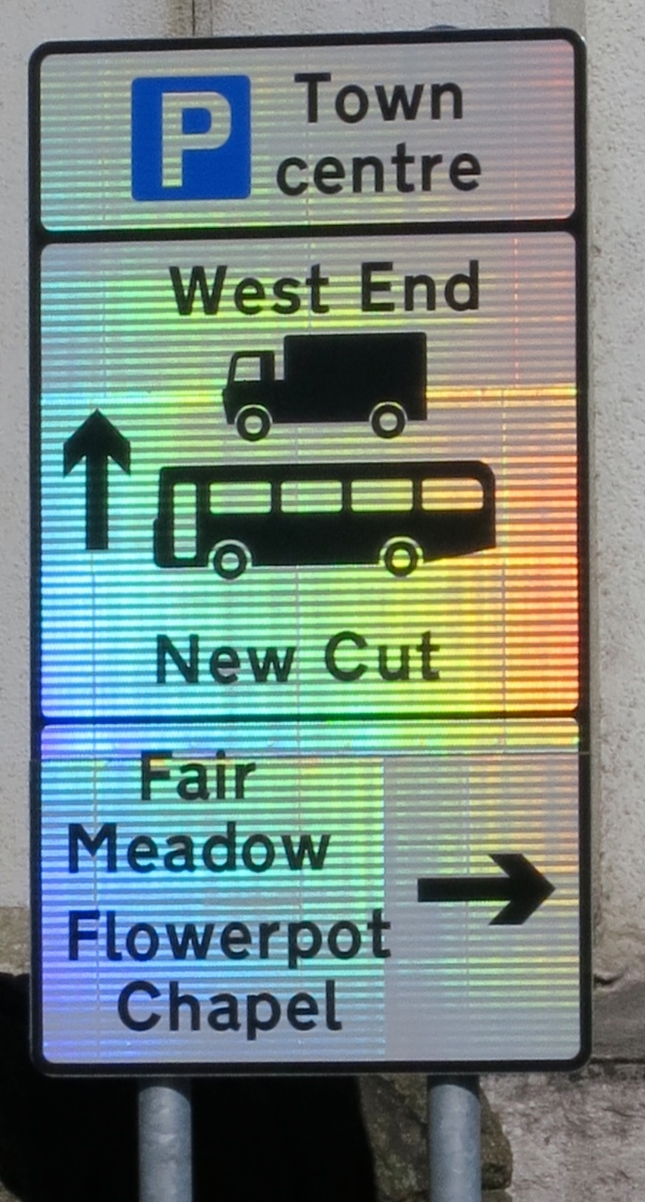 Rainbow road sign