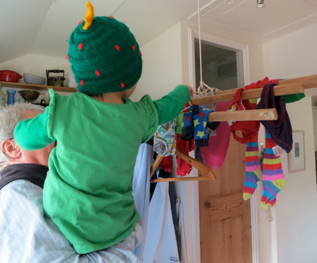 T helping to hang up the washing