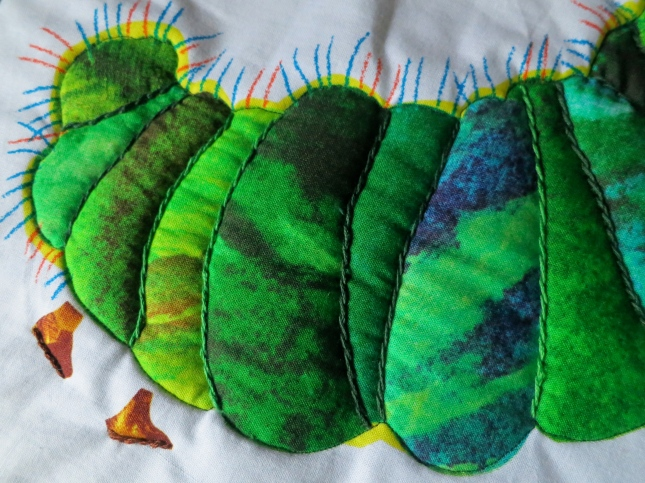 The back end of the caterpillar with stem stitch detail