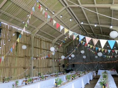 Bunting in the barn, made from fabrics with special memories for the Bride