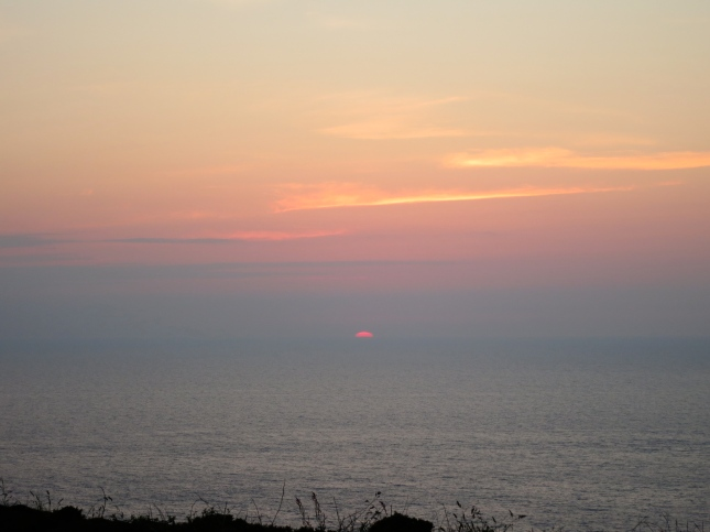 Last glimpse of the sun as it slips into the sea.