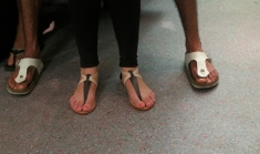 Two pairs of beautiful feet on the underground