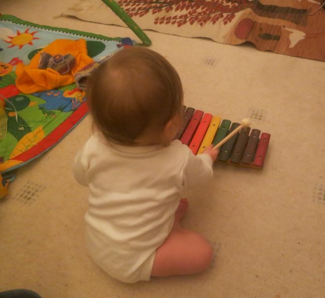 Grandbaby B playing the xylophone