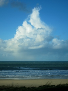Beautiful cloud, above sea, sand and cliff
