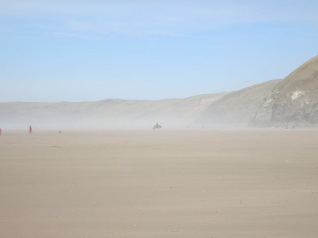 Horse rider in the mist on Perranporth Beach