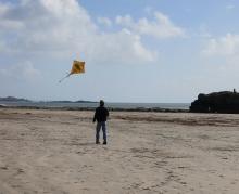 G flying the crocodile kite
