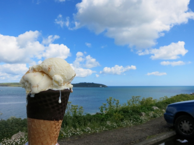 Cornish ice-cream with St Anthony Lighthouse in the distance