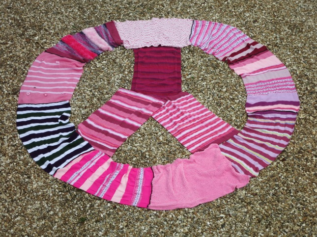 CND logo in pink wool
