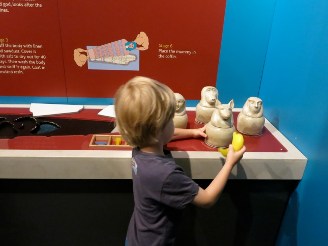 Putting the stomach into the canopic jar