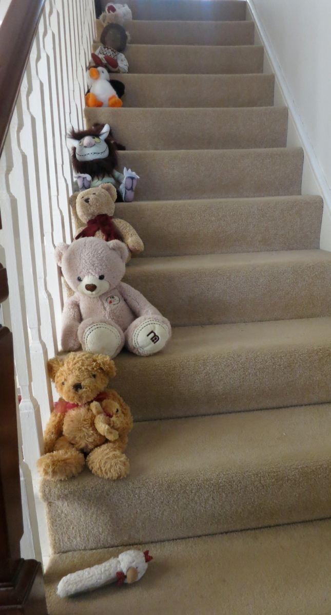 Cuddly toys up the stairs