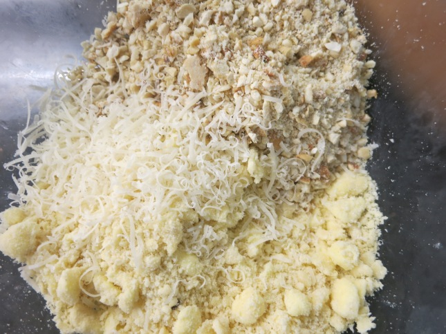 Adding the parmesan and the crushed nuts