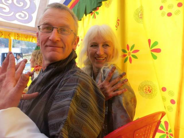 Peter Hill and Sue Hill in Thimpu, Bhutan in their local finery to meet the Princess