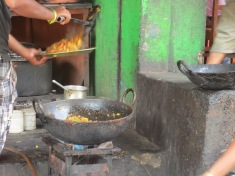 Street food moving from ladle to plate