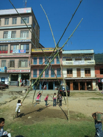 Children swinging. We saw these swings erected all the way on our journey between Kathmandu and Pokhara