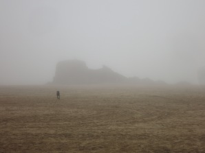 Chapel Rock in the mist with dog
