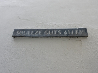 Squeeze Guts Alley, named not as we always thought for the tiny alleyway but because the fish market was next door and the fish were gutted there!