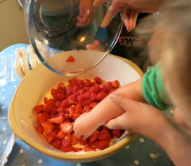 Adding the fruit to the cream