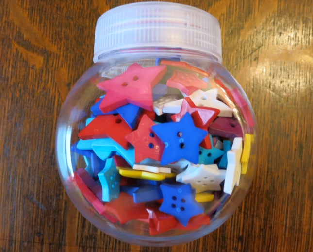 A pot full of colourful buttons