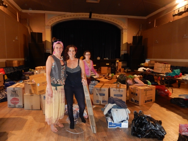 In the theatre at Princess Pavilions with boxes and boxes of donations.