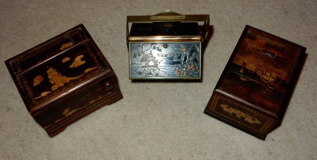 A trio of cigarette boxes
