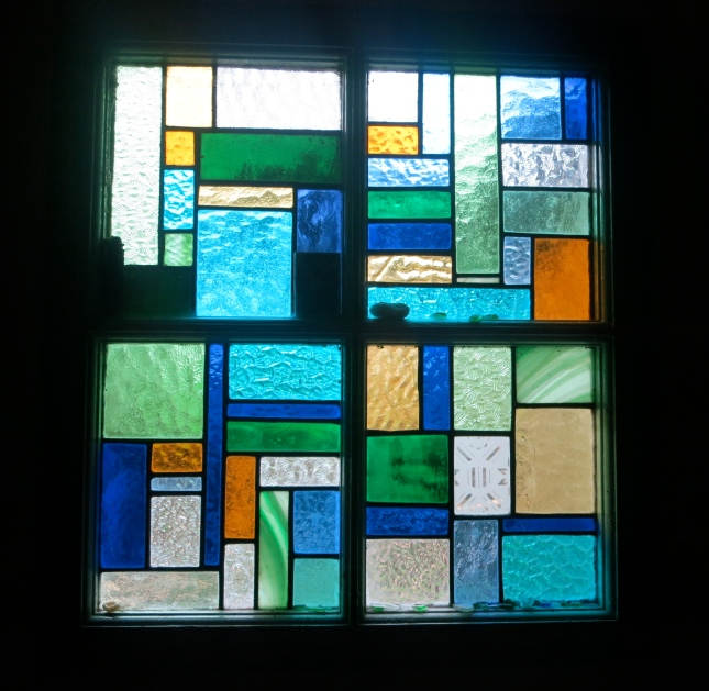 Stained glass window, one of two