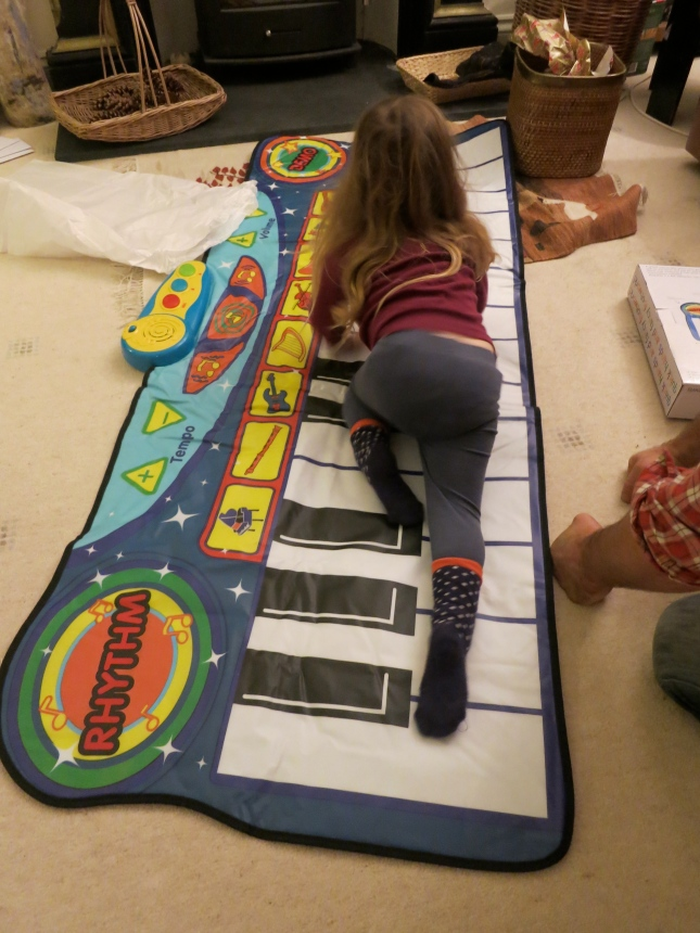 Playing on the floor piano