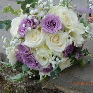 Bridesmaid's flowers in Suffragette colours