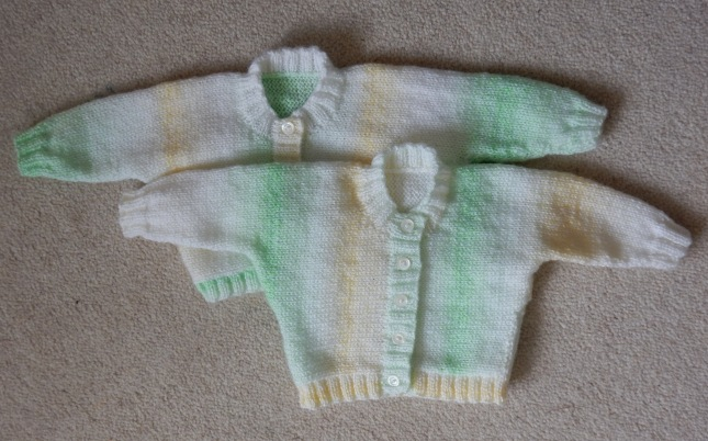 Twin cardigans with buttons from the expected babies' Great Great Grandfather