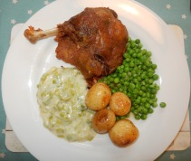 Dinner of Confit Duck with Leeks, Peas and Cornish new potatoes