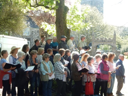 The May Carol being sung between the old and the new Churchyards