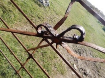 A metal bow decorating a gate